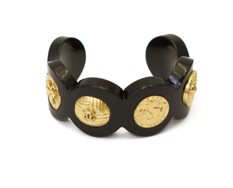 27844 - Chanel Rare Black Scalloped Acrylic Cuff with Six Gilt Chanel Motif Discs, 1991