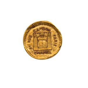"Chanel 1 5/8"" Gilt Disk Brooch Depicting Chanel Paris Storefront, 1990"