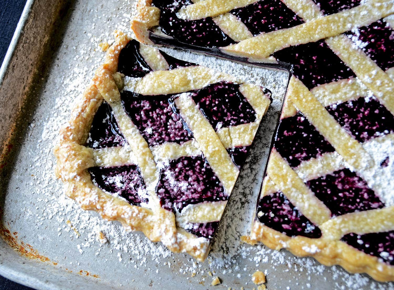 Inspired by classic linzer torte, this Mulberry Tart evokes the simplicity of days gone by. It's fruity, sweet, buttery and heaven with vanilla ice cream. | vintagekitty.com