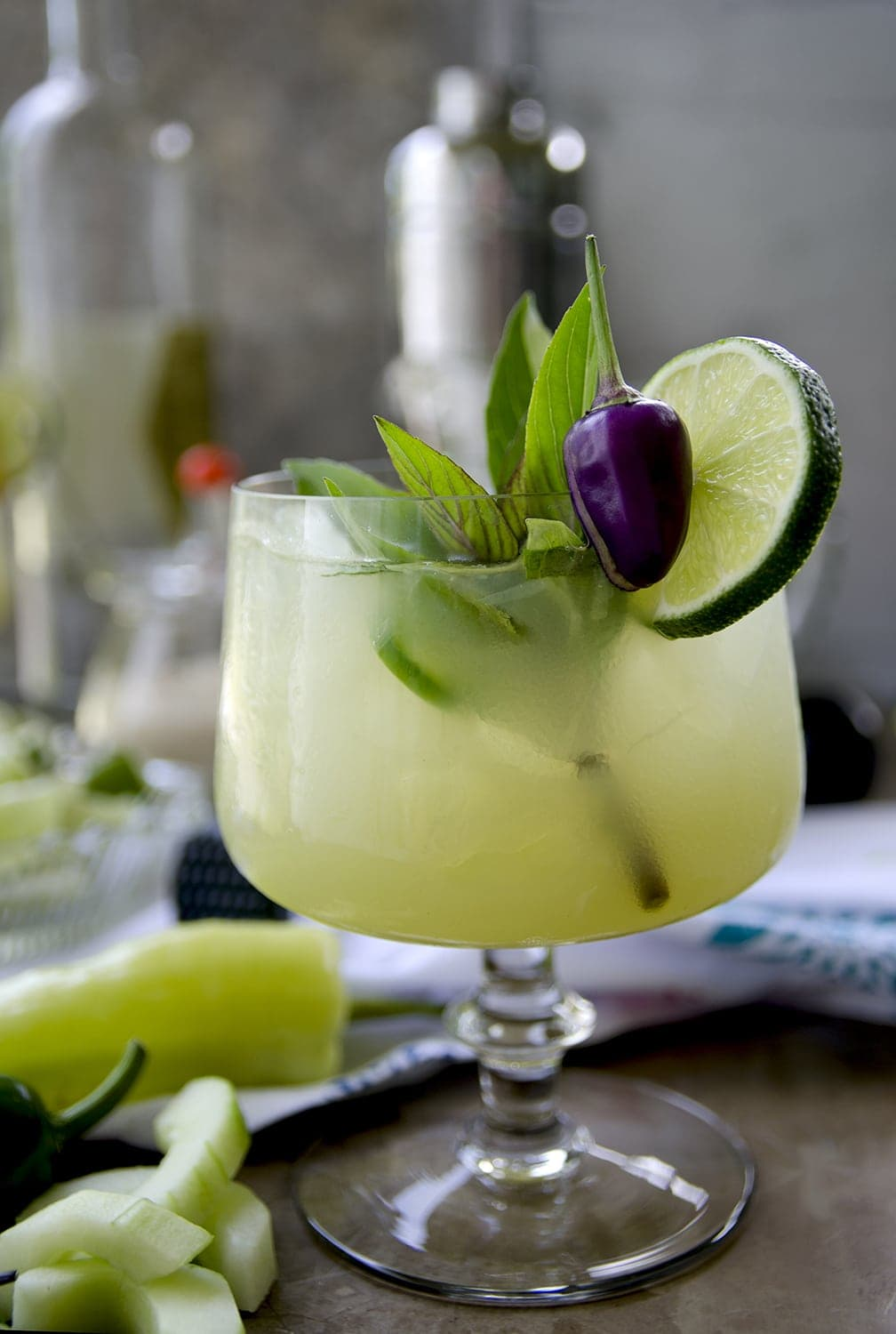 Exotic destination in glass anyone? Spicy Thai Basil Cucumber Cocktail is a sweet way to enjoy the heat of late summer! Hot, cool and refreshing… | vintagekitty.com