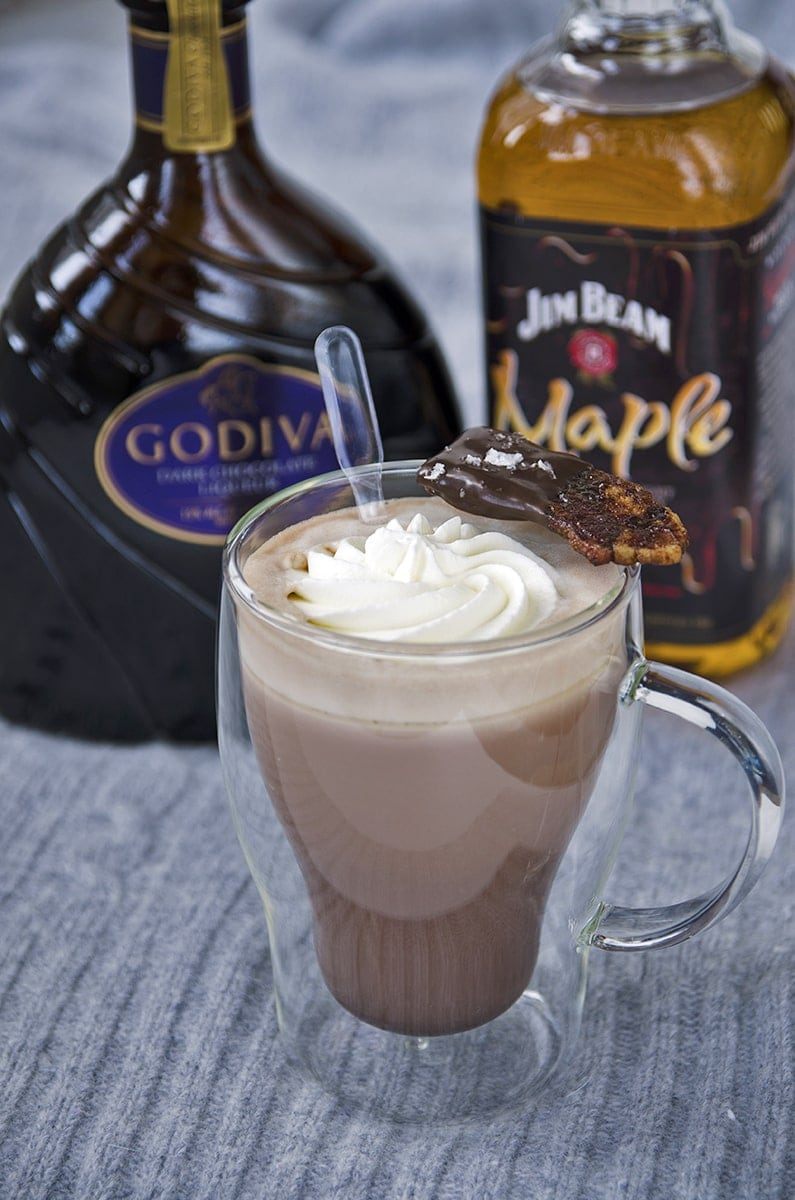 Double Chocolate Maple Hot Cocoa is just the cocktail to warm you up on chilly #Choctoberfest nights! A little Jim Beam Maple Whiskey, a shot of Godiva Chocolate liqueur and you have a sweet and smokey adult beverage that yearns to be served fireside with a piece of chocolate candied bacon! | vintagekitty.com