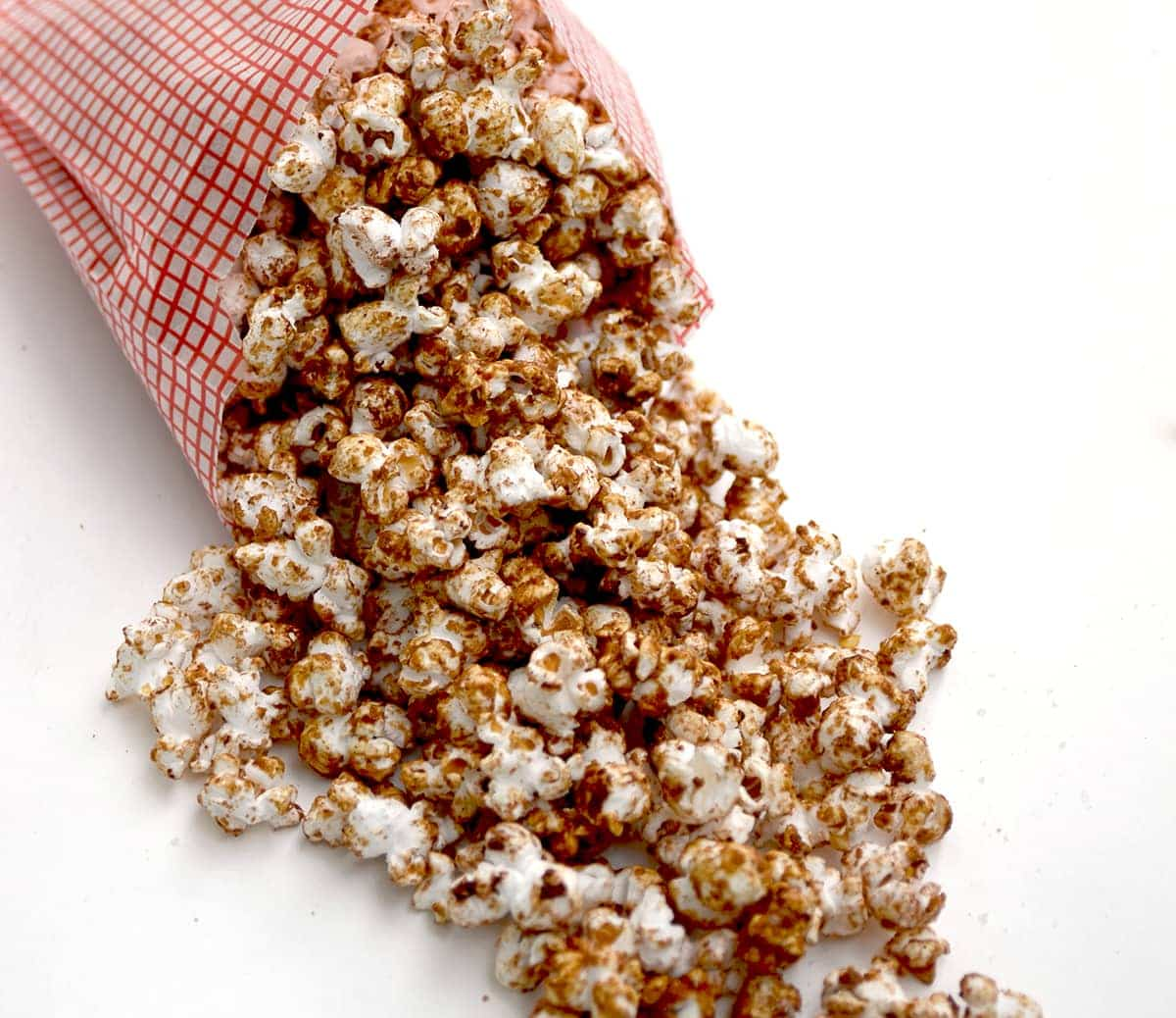 Mexican Spiced Hot Chocolate Popcorn is a perfect movie night snack for #Choctoberfest. Flavored with cocoa, cinnamon, and red chili flakes, this popcorn delights the taste buds.   vintagekitty.com