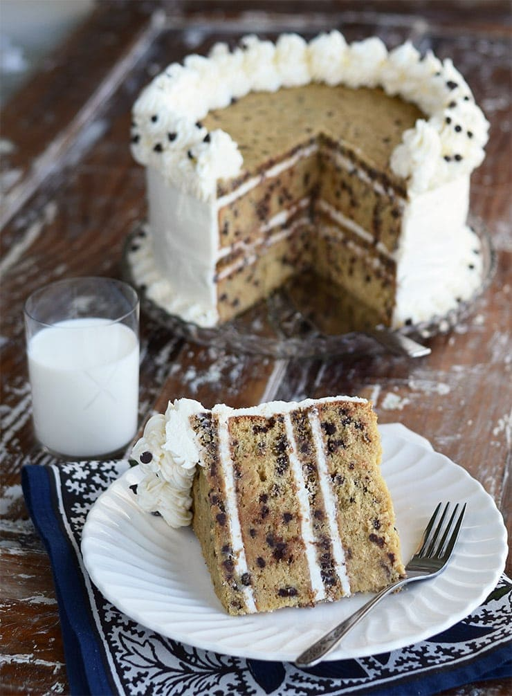 This Chocolate Chip Cookie Cake will blow your mind! Layers of cookie flavored cake alternating with vanilla bean, browned-butter chocolate chip cookies and fluffy, vanilla buttercream!