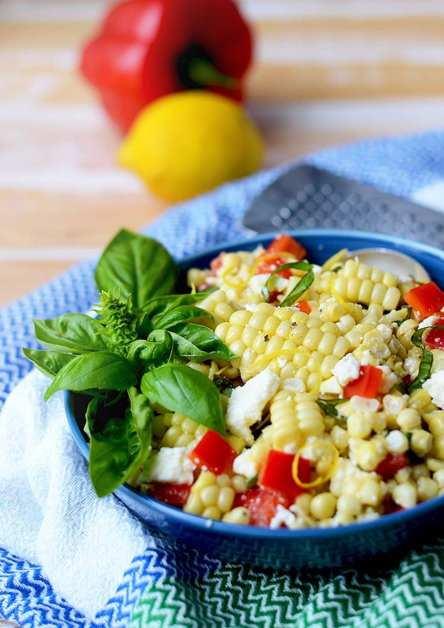 This fresh off the cob Corn Salad with Basil and Queso Fresco is a quick and easy dish side dish for summer. Delicious does not need to be complicated!