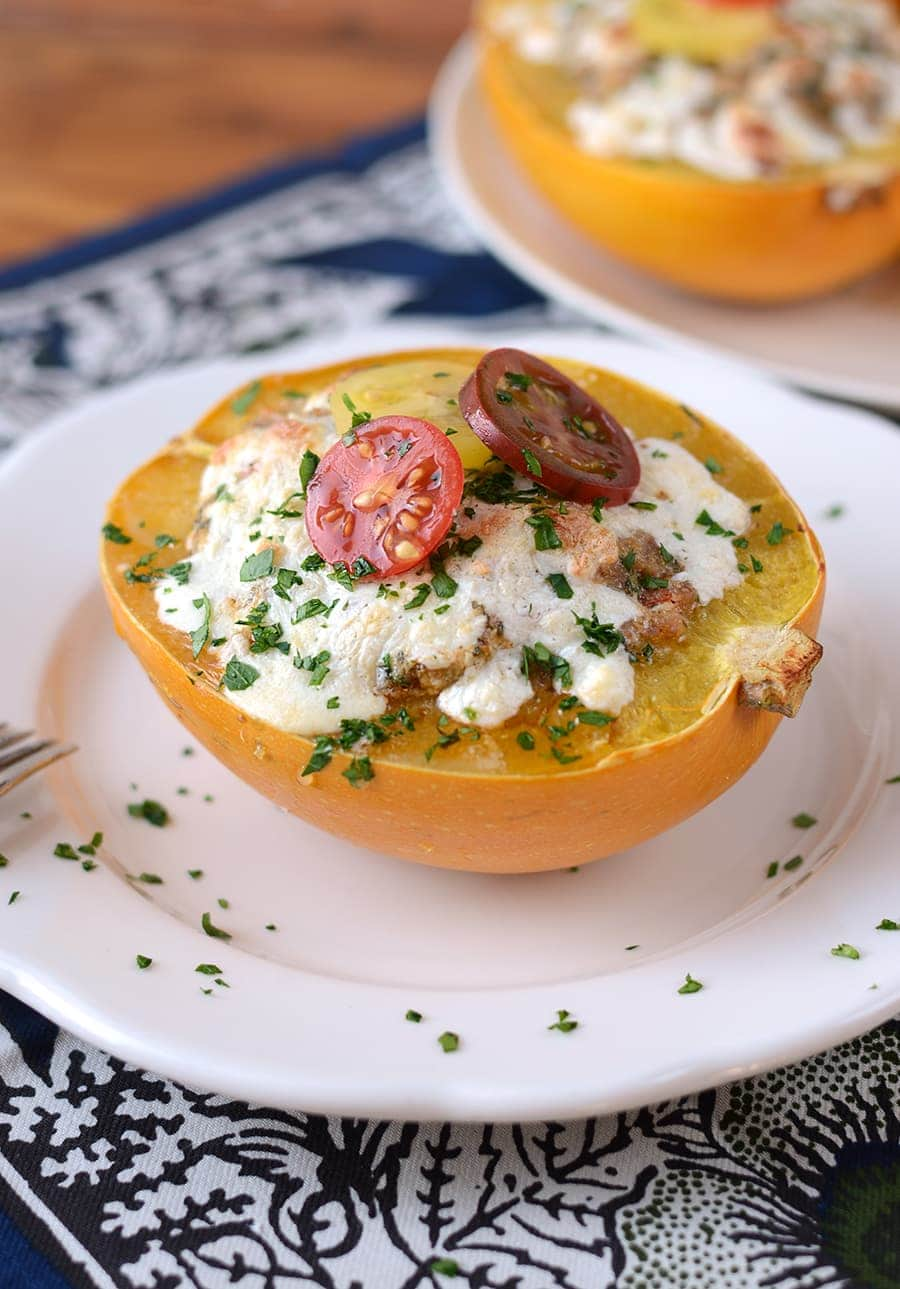 Stuffed Spaghetti Squash Boats with Italian Sausage, Tomatoes, Herbs and Mozzarella are a healthy and fast dinner with big taste! Homemade made easy!