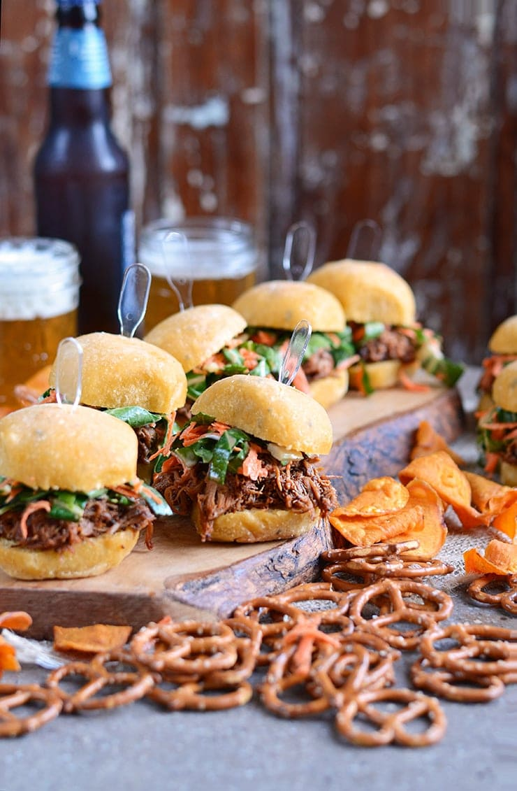 Slow Cooker Pork Barbecue Sliders are smoky and sweet with a barbecue sauce made from the pork drippings and topped with a fresh bok choy carrot slaw.   vintagekitty.com
