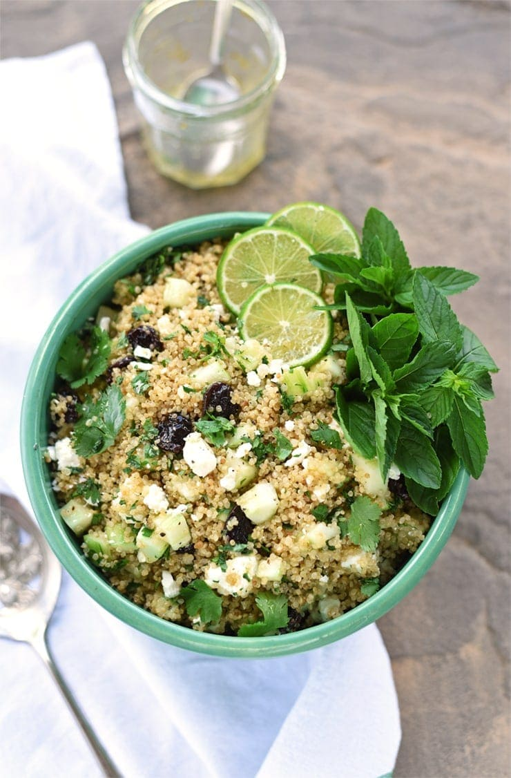 Fresh herbs, a zesty lime dressing and protein packed quinoa make this Rice Cooker Quinoa Salad pop. Plus it feeds a crowd!