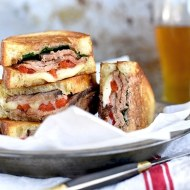 London Broil Steak Sandwich with Roasted Peppers, Spinach and Cheese