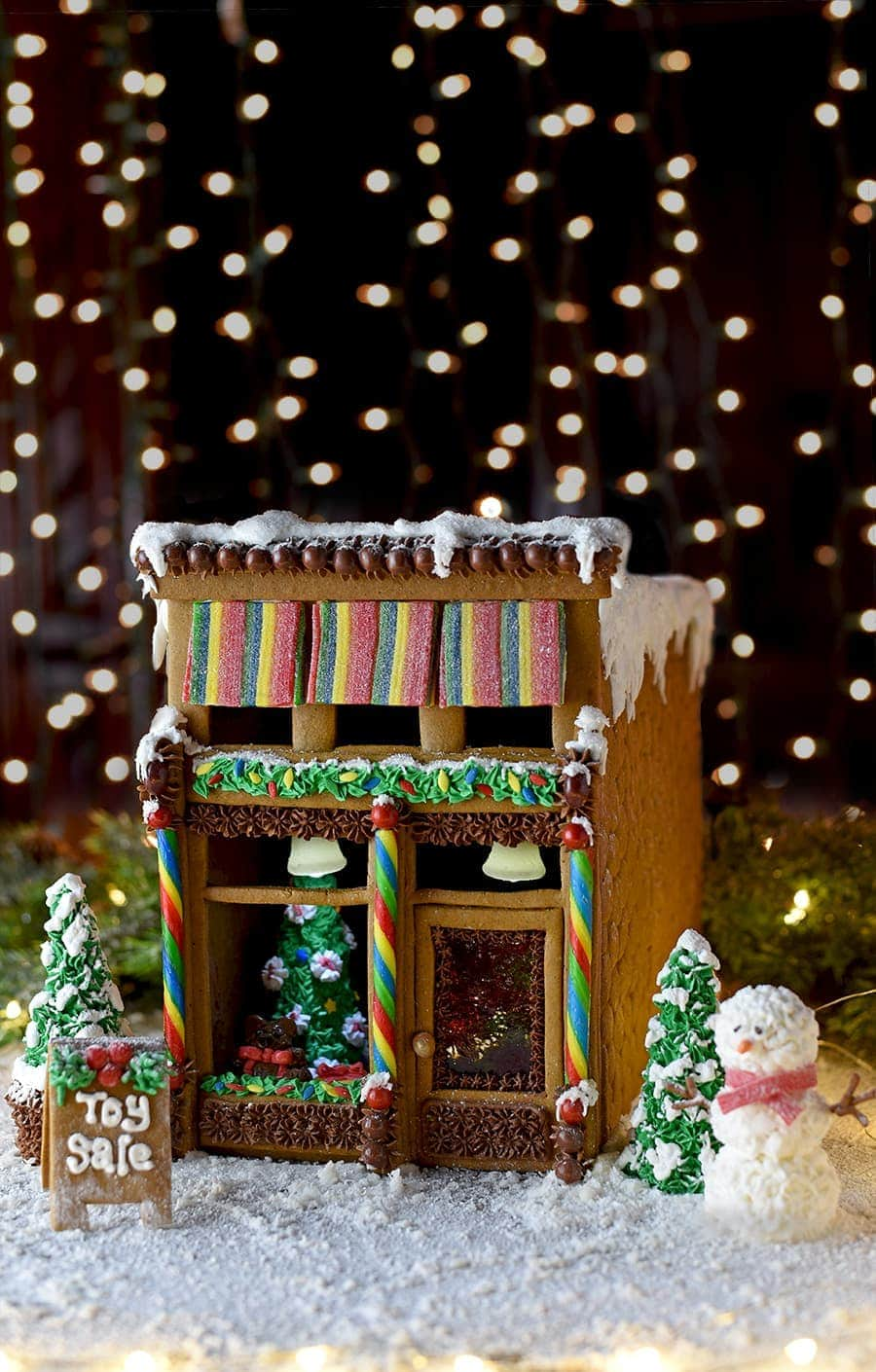 Our Victorian Storefront Gingerbread House brings the magic of a historic downtown to your house! Download our free template to make this cute toy store! It's competition worthy but its boxy design makes construction simple. #gingerbreadhouse #holidayinspiration #Christmas