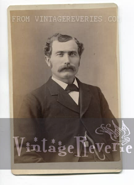 1890s man with a moustache and watch chain