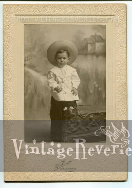 young boy 1880s elaborate frame