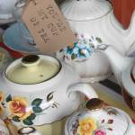 Vintage tea party china teapots and cups at a vintage wedding