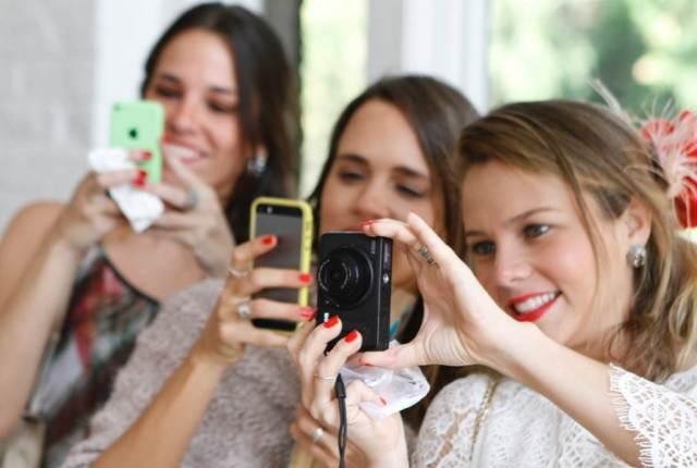 Wedding photography with mobile phones being used by Hazel Buckley as featured on the National Vintage Wedding Fair