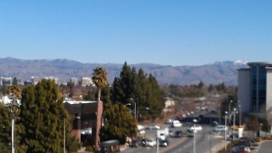 An out of focus picture of San Jose looking East with snow on Mount Hamilton