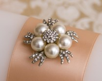 Rhinestone and pearl brooch featured on the pillar candle