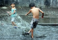 Children play during a sudden outpour in Agham Rd. QC Joan Bondoc