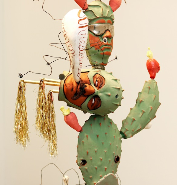 "In this image, you see a close up of a masked superhero El hombre nopal, Cactus man. A speech bubble comes out of his mouth saying, ""Our existence is our resistance,"" echoing the chanting of thousands of undocumented DACA students whose status is on limbo. This also speaks to the resistance of indigenous people in surviving genocides, cultural erasure, and oppression. Yet, we continue to sprout fruitful lives."