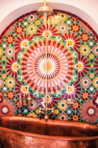 Adore the sunburst floral theme how cheerful for a bathroom & goes so well with a copper bath tub. http://salutmaroc.com
