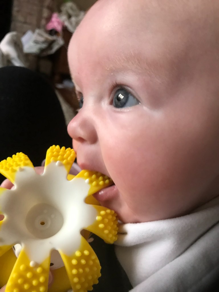 Top Tips for keeping baby cool - Aurora chewing a chilled octopus teething toy