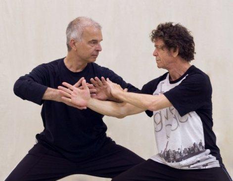 Tony Visconti (left) and Lou Reed (right) at Tai Chi Push Hands