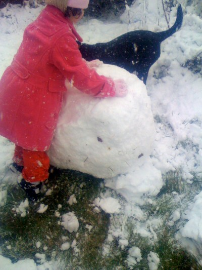 Miss L and Betty making a snowman