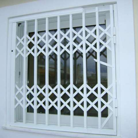 Retractable security gates in a window in a private house