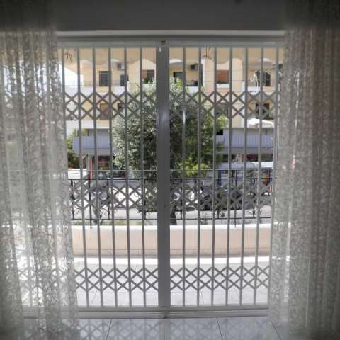 Retractable security gate for a 1st floor balcony door