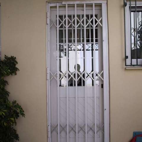 Retractable security grilles in a kitchen door