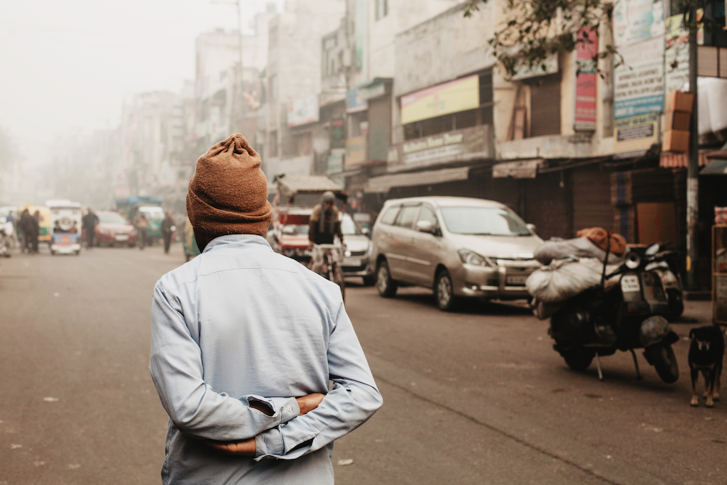 Travel Images - Man Walking on Delhi Street
