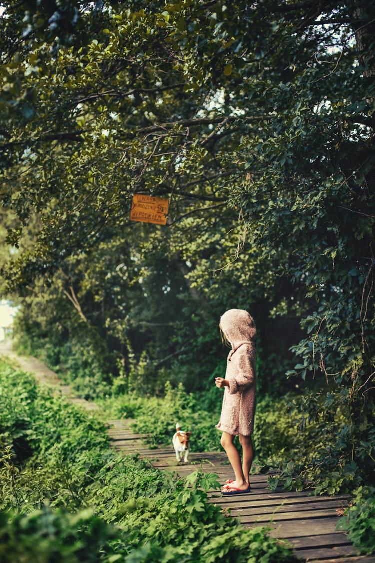 Dog follows kid