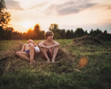 Kids Resting on Hay