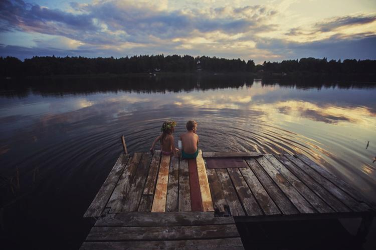Little kids on riverbank