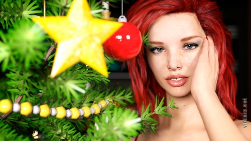 Sexy girl Emma Sweet stands near the Christmas tree and looks at the camera
