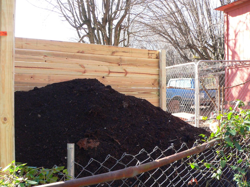A back view of the bin, before he put the last wall on it. The boys were moving around some piles...