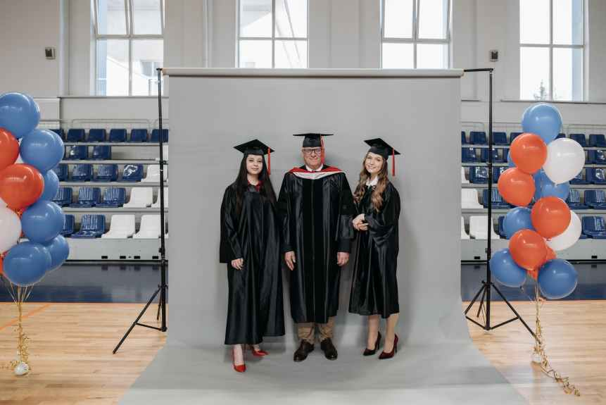 photo of people taking a graduation picture
