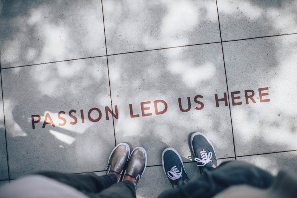 """2 pair of feet with text """"Passion Led Us Here"""""""