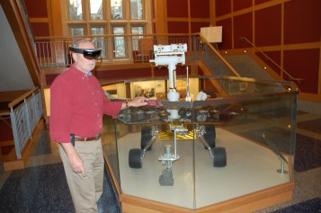 Professor Ray Arvidson tests out OnSight near the full-scale Opportunity Mars Rover in Rudolf Hall