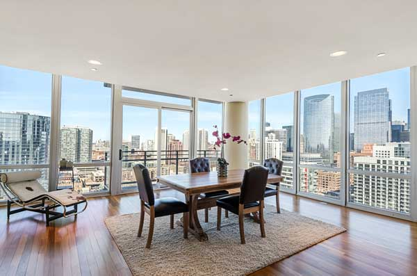dining room in a hi-rise condo with a view of the city of Chicago