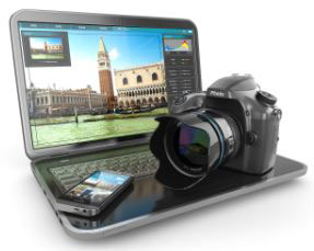 Professional Camera and a smartphone on a laptop
