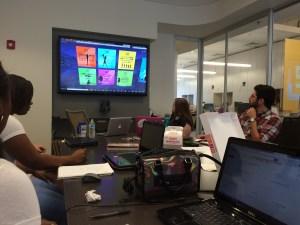 September 2, 2015: Group Meeting 3; Interns listen as Gwenette explains Virtual World assignments.