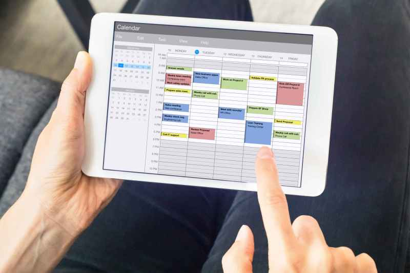 Patient scheduling an appointment on ipad Calendar app.