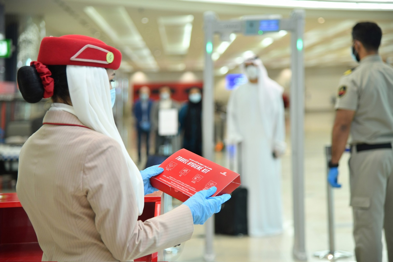 Gloves and masks are mandatory for all customers and employees at the airport in Dubai, while only masks are mandated on Emirates flights.