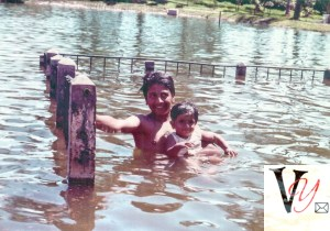 Neshmama giving swimming lessons to Rajumama in Chico