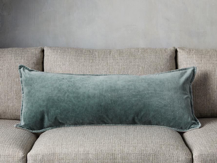 Blue velvet pillow on couch