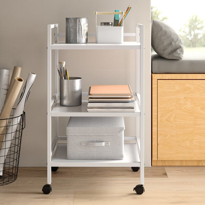 A white rolling cart for storage