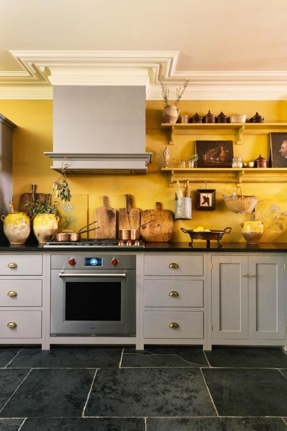 golden yellow kitchen with gray cabinets and open shelving