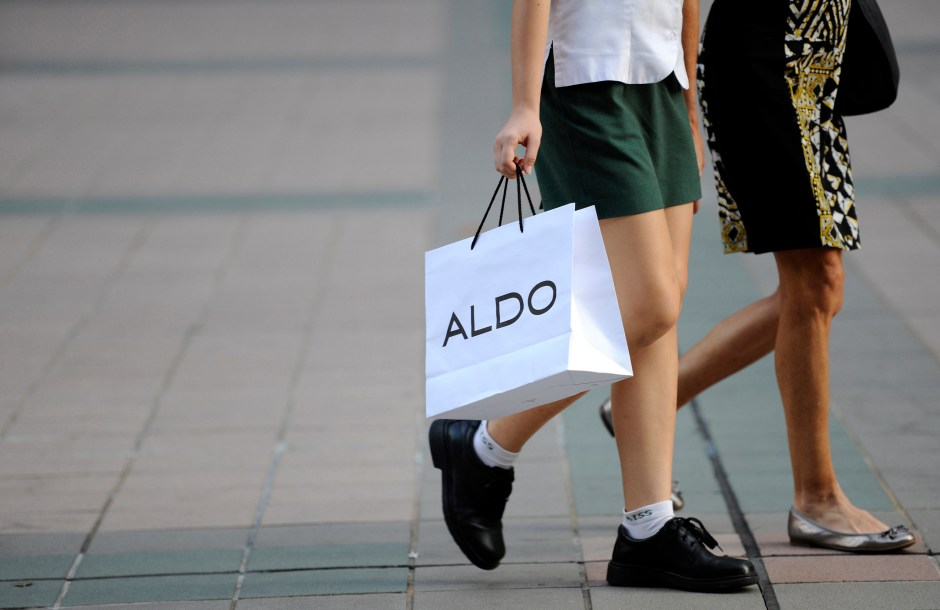 A shopper carries an Aldo Group Inc. shopping bag in Singapore, on Thursday, June 14, 2012. Photographer: Munshi Ahmed/Bloomberg