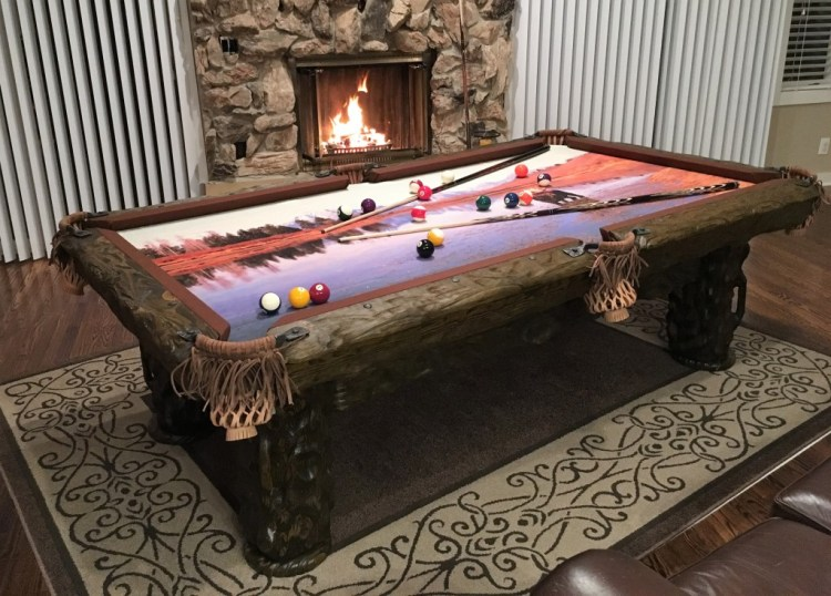 Wilderness rustic log pool table by Vision Billiards by fireplace
