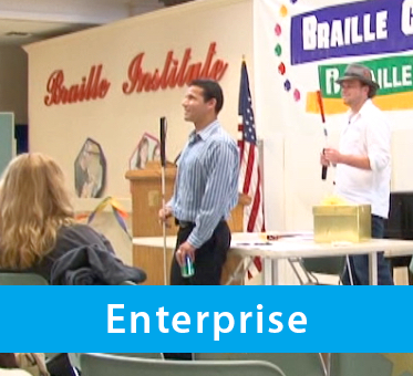 Photo for the Enterprise drop-down banner shows World Access For The Blind Perceptual Navigation Instructors Juan Ruiz and Brian Bushway delivering a presentation at an organization. Click the down arrow to expand the text banner.