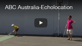 Video Image: Daniel Kish works with a blind young male student playing rollerball in Australia.